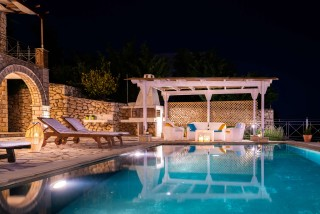 villa emma arriva pool by night